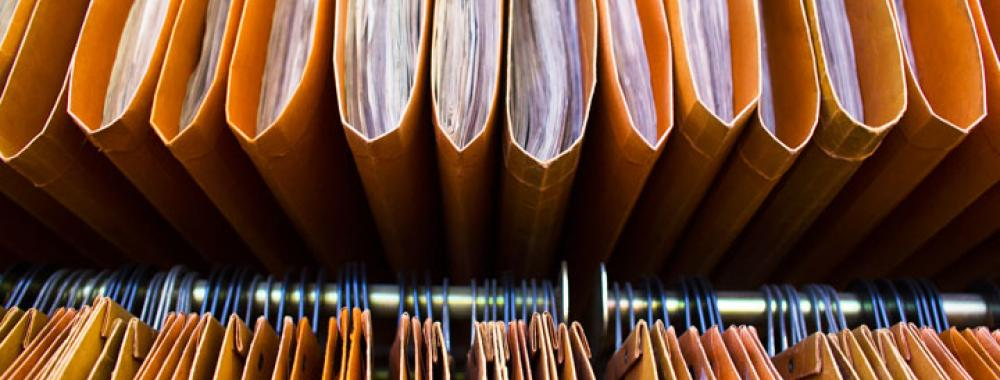 a close-up shot of a row of hanging files
