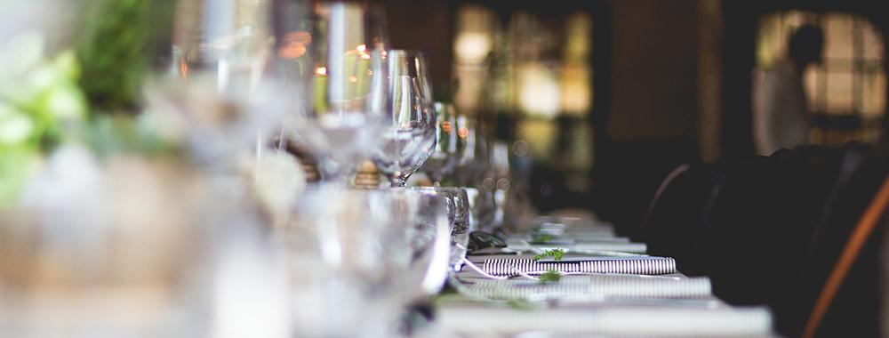 view along a table set with wine glasses and plates
