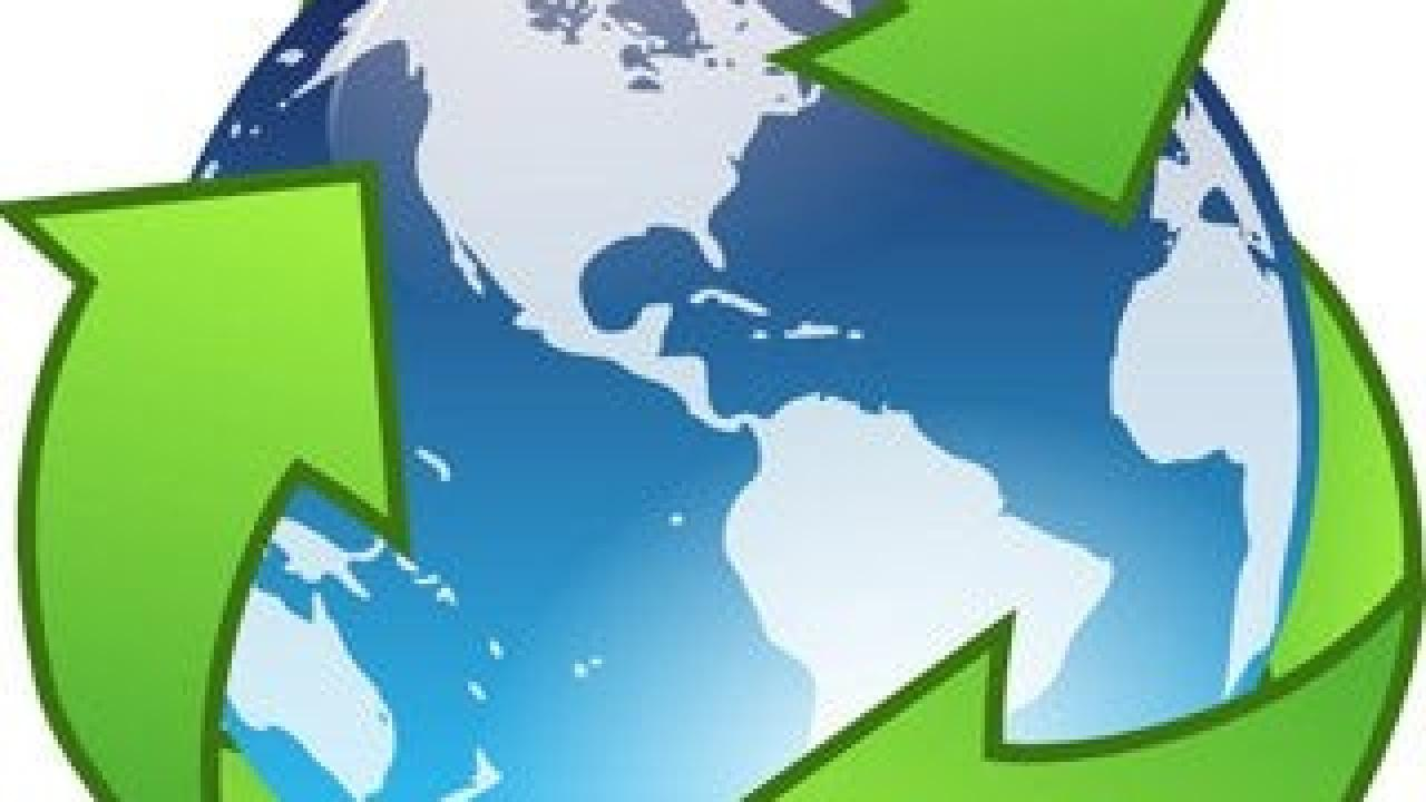 Photo of Recycle Symbol with Planet Earth in Background