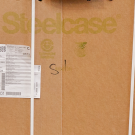 stack of steelcase furniture boxes